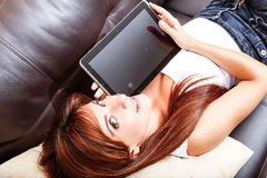 Young woman showing a Tablet PC Stock Photo