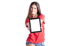 Young woman showing a tablet PC Royalty Free Stock Photography