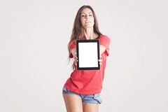 Young woman showing a tablet PC Royalty Free Stock Image