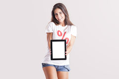 Young woman showing a tablet PC Royalty Free Stock Photo