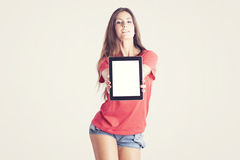 Young woman showing a tablet PC Stock Images