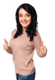 Young woman is showing thumb up gesture Stock Images