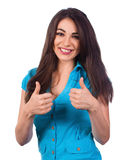 Young woman is showing thumb up gesture Stock Photo