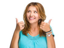 Young woman is showing thumb up gesture Stock Photos