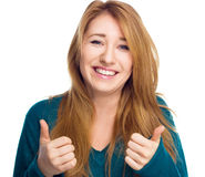 Young woman is showing thumb up gesture using both hands on white Royalty Free Stock Photo
