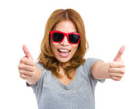 Young woman showing thumb up Stock Photos