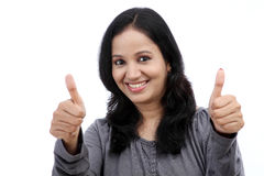 Young woman showing thumb up symbol by two hands Royalty Free Stock Image