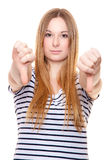 Young woman showing thumbs down Stock Photography