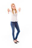 Young woman showing thumbs down sign with both hands Royalty Free Stock Photography