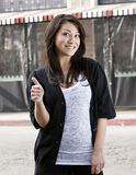 Young woman showing a thumbs up Stock Image