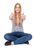 Young woman showing thumbs up Stock Image