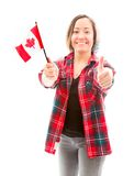 Young woman showing thumbs up sign with holding Canada flag Stock Photography