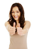 Young woman showing thumbs up. Royalty Free Stock Photography