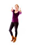 Young woman showing thumbs up towards camera with both hands Stock Photos