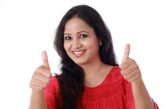 Young woman showing thumbsup gesture royalty free stock image