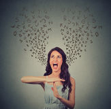 Young woman showing time out hand gesture, frustrated screaming Stock Images