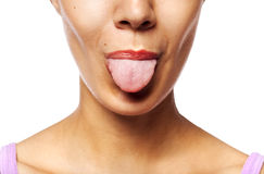 Young woman showing tongue Royalty Free Stock Image