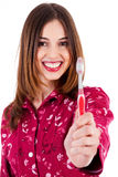 Young woman showing toothbrush Stock Photo
