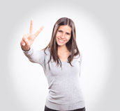 Young woman showing two fingers stock photos