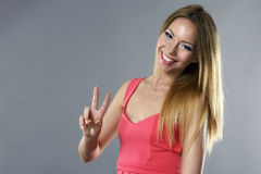 Young woman showing two fingers, positive Stock Image