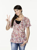 Young woman showing victory sign Stock Image