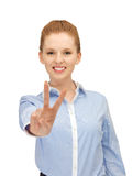Young woman showing victory sign Royalty Free Stock Image