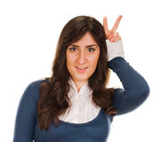 Young woman showing victory sign Stock Images