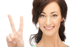 Young woman showing victory sign Stock Photo
