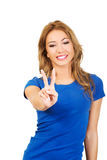 Young woman showing victory sign. Royalty Free Stock Photos
