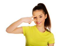 Young woman showing victory sign. Royalty Free Stock Photography