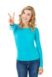 Young woman showing victory sign Stock Photos