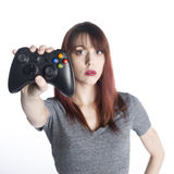 Young Woman Showing Video Game Joysticks Royalty Free Stock Photography