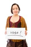 Young woman showing vote sign on white background Royalty Free Stock Photos