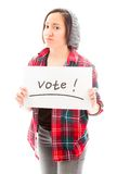 Young woman showing vote sign on white background Stock Photos
