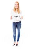Young woman showing vote sign on white background Royalty Free Stock Photography