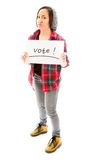 Young woman showing vote sign on white background. Caucasian young adult woman in studio isolated on white background Stock Images