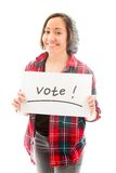 Young woman showing vote sign on white background Stock Images