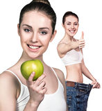 Young woman showing weight loss result Stock Photo