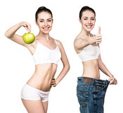 Young woman showing weight loss result Royalty Free Stock Images