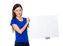 Young woman showing with white banner Royalty Free Stock Images