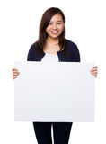 Young woman showing the white banner Royalty Free Stock Photography