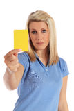 Young woman showing a yellow card. Attractive young woman showing a yellow card. All on white background Royalty Free Stock Photography