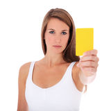 Young woman showing yellow card Royalty Free Stock Photos