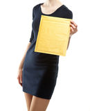 Young woman showing yellow envelope Stock Photography