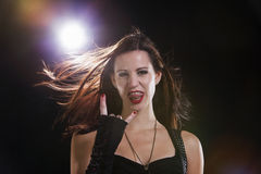 Young Woman Showing Yo Sign. Indoors Royalty Free Stock Images