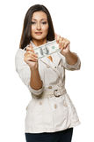 Young woman showing you a dollar note Stock Images