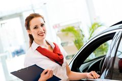 Young woman in a showroom consultant Stock Image