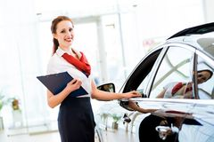 Young woman in a showroom consultant Stock Photos
