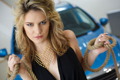 Young woman in the showroom with a new car with ro Royalty Free Stock Images