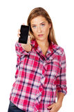 Young woman shows broken mobile phone.  royalty free stock image